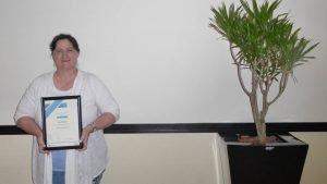 Lana Woollgar showing off her training certificate