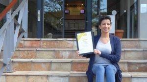 Arlene Cloete showing off her training certificate