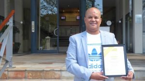 Harold Booysen showing off his training certificate